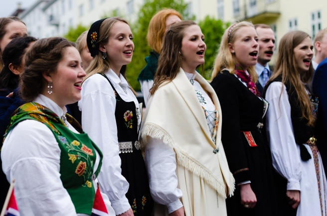 People in traditional dresses performing in Bergen, Norway